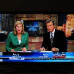 Two TV news anchors appearing on TV